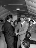 Howard Hughes Greeting Cary Grant Aboard Plane as He Prepares to Take Movie Stars