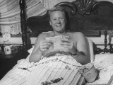 Actor Van Johnson Smiling as He Reads Fan Mail in Bed at Home