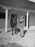 Joseph Richards Tending to His Horse at Rolling Rock Fox Hunt