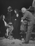 Howard Hawkes Chatting on the Set of a Movie with Two Actresses