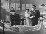 "Tyrone Power and Joan Fontaine and Other Actors in Hospital Scene from Film ""This Above All"""
