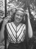 Actress Laraine Day Sitting in a Swing