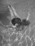 Singer/Actress Julie London Swimming in a Pool