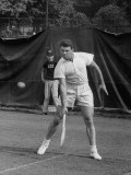 Tennis Player Pierre Pellizza in Action
