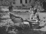 Two Army Wives Watching their Children Playing in Water Tubs in Back Yard