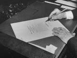 Hands of President Franklin Roosevelt Signing Declaration of War Following Bombing of Pearl Harbor