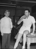 Errol Flynn Taking a Drink on Day of Tennis Match with Bill Tilden