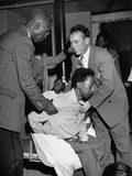 Faith Healers Attempting to Cure a Man During a Religious Service