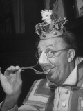 Comedian Ed Wynn Clowning Using a Cheese Fork to Prevent Suffocating from Odor of Limburger