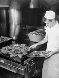 A Sailor Cooking Meat for the Crew Aboard a US Navy Cruiser