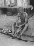 Chinese Soldier Making His Own Straw Sandals