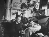 Naval Officers Reading Magazines and Propping their Feet on the Mess Table