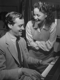 Actress Alida Valli Listening to Husband Oscar De Mejo Play the Piano