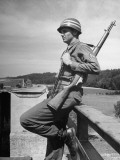 Soldier Standing on Bridge
