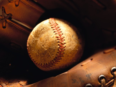 Old Baseball in Glove Stretched Canvas Print