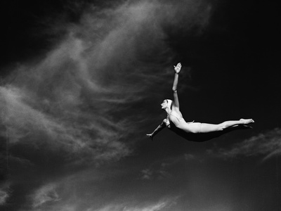 Woman Performing Swan Dive Stretched Canvas Print