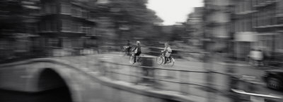 Rear View of Three People Cycling, Amsterdam, Netherlands Stretched Canvas Print