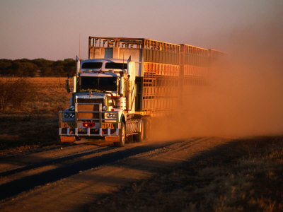 Road Train Driving along Dusty Road, Kynuna, Australia Stretched Canvas Print