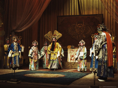 opera performance with seven people standing in a semicircle, wearing elaborate Chinese costumes