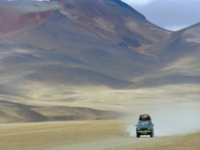 4 Wheel Drive Car Driving Through a Colourful Volcanic Landscape Near Las Rocas De Dali Stretched Canvas Print