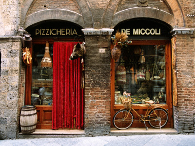 Bicycle Parked Outside Historic Food Store, Siena, Tuscany, Italy Stretched Canvas Print