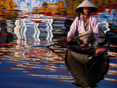 Woman in Boat, Reflection of Newly Painted Boat on Perfume River, Hue, Thua Thien-Hue, Vietnam Stretched Canvas Print
