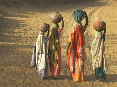 Girls Wearing Sari with Water Jars Walking in the Desert, Pushkar, Rajasthan, India Stretched Canvas Print