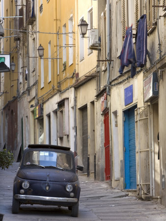 Fiat Driving in Narrow Street, Sassari, Sardinia, Italy Stretched Canvas Print