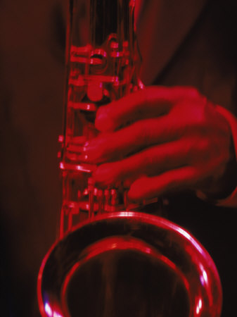 Close-up of Man Playing Saxophone in Jazz Club Stretched Canvas Print