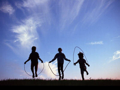 Silhouette of Children Playing Outdoors Stretched Canvas Print