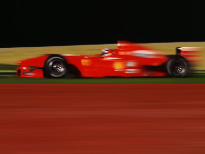 Formula One-Ferrari in Motion Stretched Canvas Print