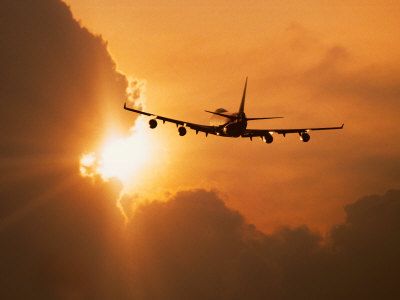 Jumbo Jet Banking Into Sunset Stretched Canvas Print