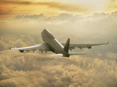 Jumbo Jet Above Clouds at 35,000 Feet Stretched Canvas Print