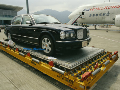 Luxury Bentley Unloaded from an Airplane at Chek Lap Kok Airport Stretched Canvas Print