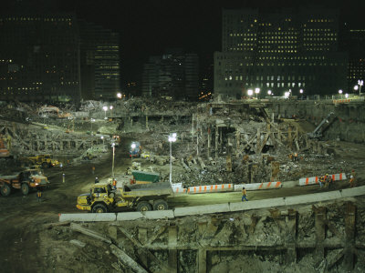 An Elevated View of Ground Zeros Devastation at Night; Crews, Their Vehicles, and Other Equipment Stretched Canvas Print
