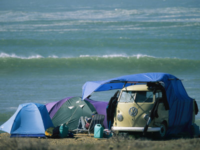 Campsite on Oceans Edge with Tents, VW Camper and Surfer in a Chair Stretched Canvas Print