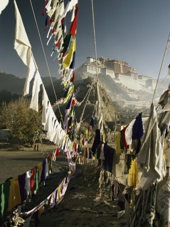 Prayer Flags Hang in the Breeze Below the Potala Stretched Canvas Print
