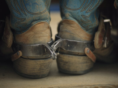 Close up Detail of Cowboy Boots with Well-Worn Spurs Stretched Canvas Print