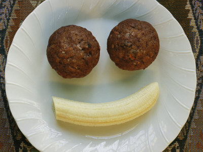 Smiling Breakfast of Muffins and a Banana Stretched Canvas Print