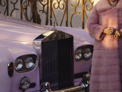A Woman Wearing a Pink Mink Coat Stands Next to a Pink Rolls Royce Stretched Canvas Print
