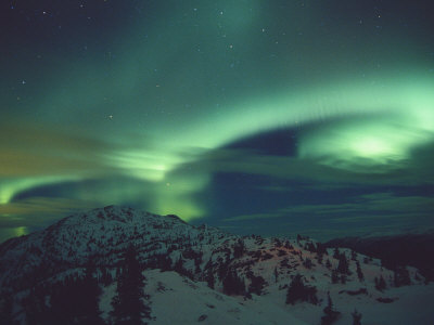A Brilliant Display of Aurorae over Grey Mountain Stretched Canvas Print