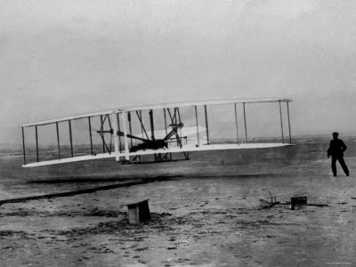 Orville Wright Taking Plane For 1st Motorized Flight as Brother Wilbur Wright Looks at Kitty Hawk Stretched Canvas Print