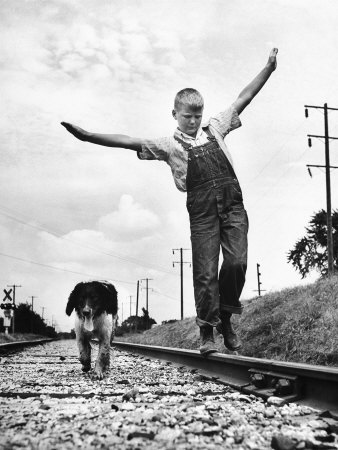 Larry Jim Holm with Dunk, His Spaniel Collie Mix, Walking Rail of Railroad Tracks in Rural Area Stretched Canvas Print