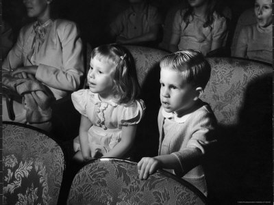 Children Watching Cartoons in a Movie Theater Stretched Canvas Print