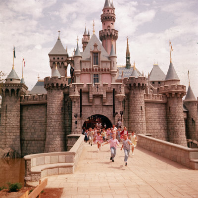 Children Running Through Gate of Sleeping Beauty's Castle at Walt Disney's Theme Park, Disneyland Stretched Canvas Print