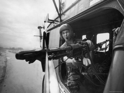 Crew Chief Lance Cpl. James C. Farley Manning Helicopter Machine Gun of Yankee Papa 13 Stretched Canvas Print
