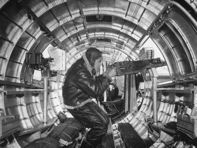 Crewman Poking His 50 Cal. Machine Gun Out of Side Window of B-17E Flying Fortress During WWII Stretched Canvas Print