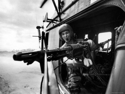 Helicopter Crew Chief James Farley Using M-60 Machine Gun in Landing Zone Near Da Nang Stretched Canvas Print