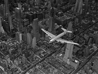 Aerial View of a DC-4 Passenger Plane Flying over Midtown Manhattan Stretched Canvas Print