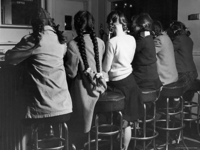 """Girls Known as """"Pigtailers"""" Sitting on Stools at Soda Fountain Stretched Canvas Print"""